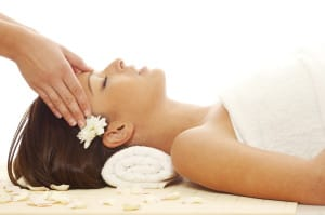 Young attractive girl receiving head massage at spa resort